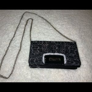 COACH signature 4 1/2 in by 9 in black purse.